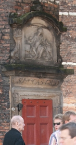 This cornice marks the entrance to Amsterdam's Guild of St. Luke. Luke is the patron saint of artists. The guild included fine painters, sculptors, engravers, and other visual artists.